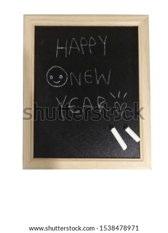 The word happy new year on the blackboard.Chalk and blackboard on a white background. #1538478971