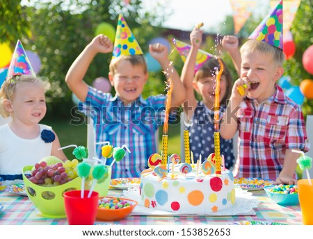 Group of adorable kids having fun at birthday party  #153852653