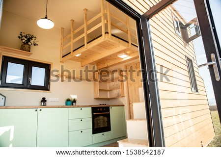 Mobile tiny house, great for outdoor experiences and holidays. Royalty-Free Stock Photo #1538542187