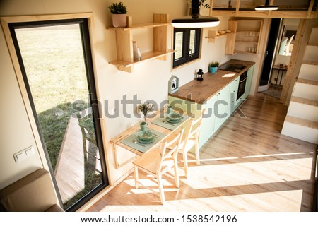 Mobile tiny house, great for outdoor experiences and holidays. Royalty-Free Stock Photo #1538542196