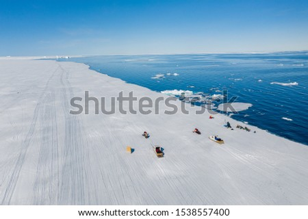 Aerial drone photo of tourists visit the floe edge near Sirmilik National Park in Nunavut, Canada #1538557400