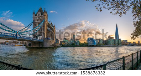 Tower bridge and famous landmarks of London on Thames riverside in fall season, Great Britain #1538676332