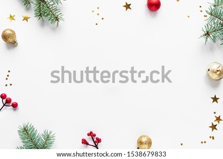 Christmas Background with fir branches, golden and red ornaments and stars, isolated on white background,  copy space. Christmas creative flat lay, concept with festive ornaments.
