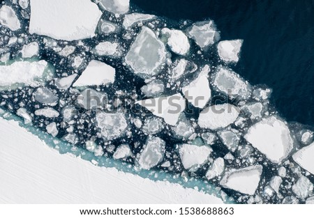 Melting ice near Sirmilik National Park on Bylot Island. Pond Inlet, Nunavut, Canada #1538688863