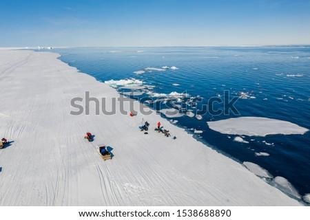 Tourists visit the flo edge near Sirmilik National Park in Nunavut, Canada #1538688890