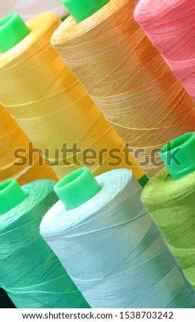 close-up detail of many colored spool of thread for sale #1538703242