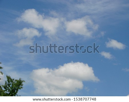 Beautiful blue sky with sunbeams and clouds. Sun rays. #1538707748