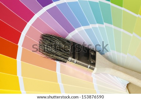 a brush lies on color tables - suggestions for rooms, interiors etc.