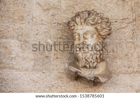 ATHENS, GREECE - APRIL, 2018: Head of a Triton from the Odelon of Agrippa at the Stoa of Attalos in Athens #1538785601