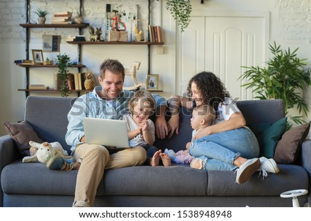 Young beautiful happy family relaxing at home #1538948948