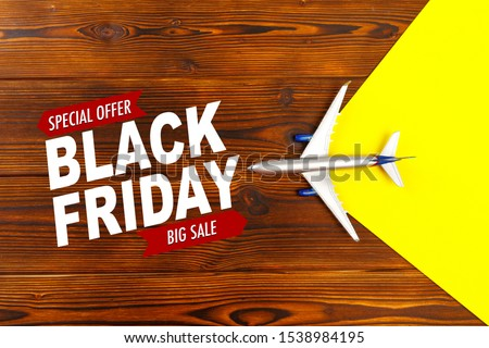 top view photo of toy airplane over wooden background.Black friday sale - Image