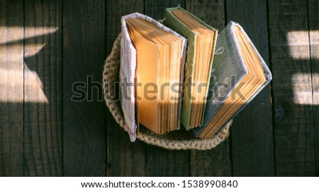 Homemade product, diy small kraft paper notebook with book cover recycle from old pants, group of handbook with vintage style in morning sunlight ray #1538990840
