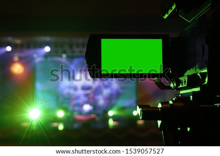 Live concert camera with green screen monitor light green
