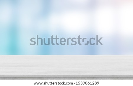 blurred inside of interior luxury modern bathroom in the morning background with white wood tabletop for show, promote ads and design product on display concept Royalty-Free Stock Photo #1539061289
