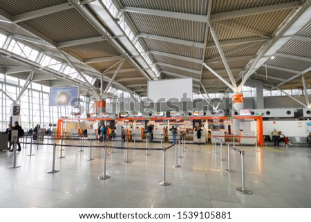 Warsaw, Poland - September 21 2019: Some people at the registration desk inside the Chopin terminal airport #1539105881