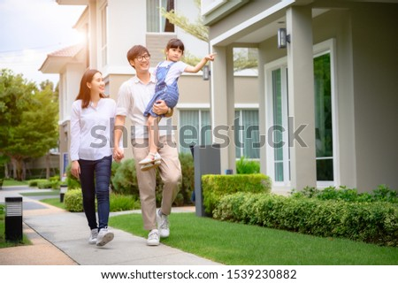 family walking on the model new house looking for living life future, new family meet new house #1539230882