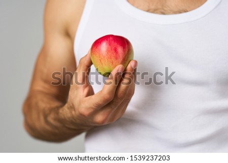 young man isolated background in white t-shirt with apples #1539237203