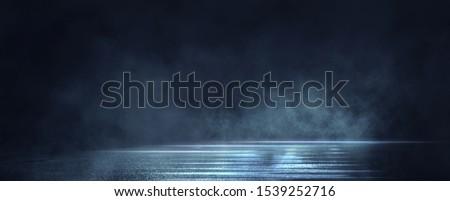 Dark street, wet asphalt, reflections of rays in the water. Abstract dark blue background, smoke, smog. Empty dark scene, neon light, spotlights. Concrete floor #1539252716