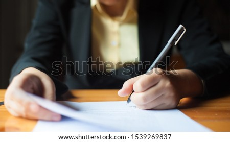 Close-up of pictures, signing of contracts, legal agreements or business agreements. #1539269837