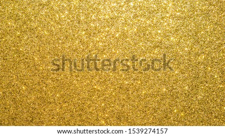 Gold glitter texture background sparkling shiny wrapping paper for Christmas holiday seasonal wallpaper  decoration, greeting and wedding invitation card design element #1539274157