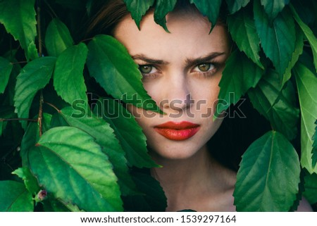 Beautiful woman red eyes green leaves nature tropics exotic #1539297164
