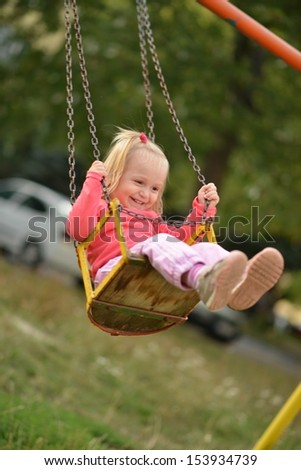 Baby girl in swing #153934739
