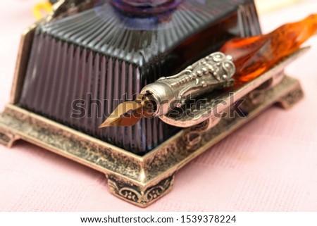 Old ink pen and ink bottle #1539378224