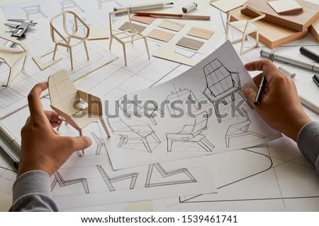 Designer sketching drawing design development product plan draft chair armchair Wingback Interior furniture prototype manufacturing production. designer studio concept .                            #1539461741