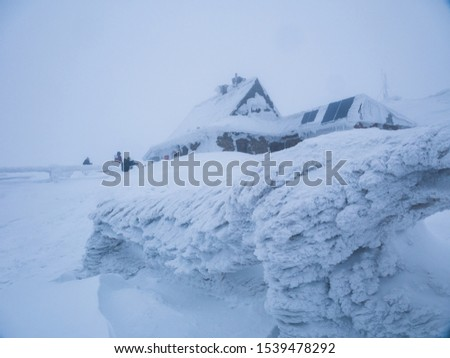 Mountaing cabin covered in snow. #1539478292