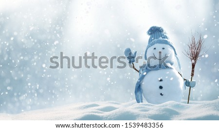 Merry christmas and happy new year greeting card with copy-space.Happy snowman standing in christmas landscape.Snow background.Winter fairytale. #1539483356