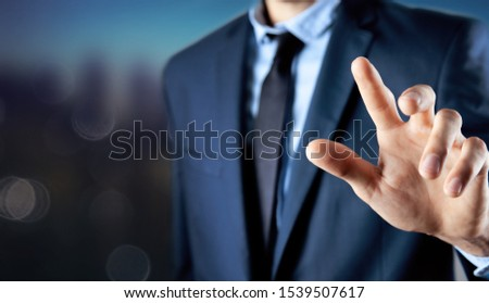 business man presses on touch screen #1539507617