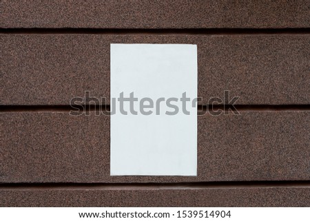 clear empty white blank signboard blank for your text on brown mosaic marble plaster wall. copy space #1539514904