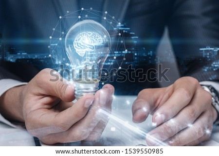 The concept and idea brainstorming. Businessman showing light bulb with a burning brain. #1539550985
