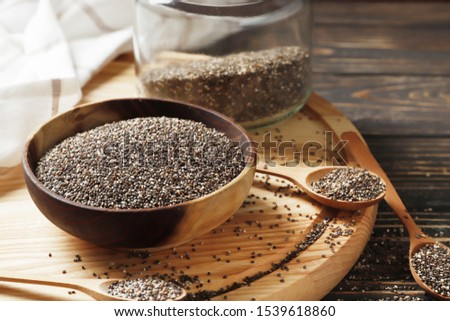 chia in wood bowl with wooden spoons on a background close-up #1539618860