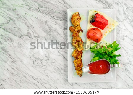 barbecue with grilled vegetables, onions and sauce #1539636179