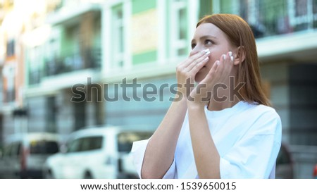 Girl closing nose with hand, unpleasant harmful smell in area, air pollution #1539650015