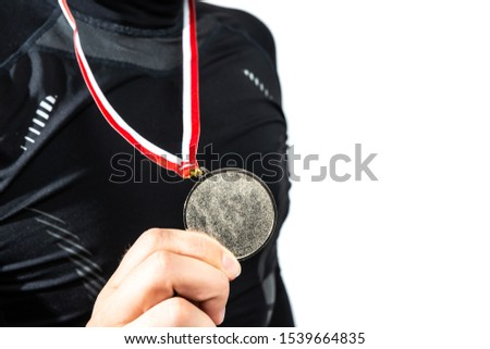 The athlete is happy with the silver medal, second place. Player happy to win a silver medal. The concept of tournaments and competitions. Victory, winning competitions. #1539664835