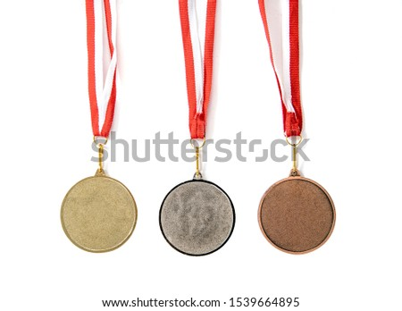 Medals isolated on white. Gold, silver and bronze medal on a dark background. The concept of tournaments and competitions. Victory, winning competitions. #1539664895