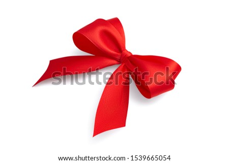 Side view of a beautiful red bright festive four-loop satin ribbon gift bow with gray light soft shadow isolated on white background #1539665054