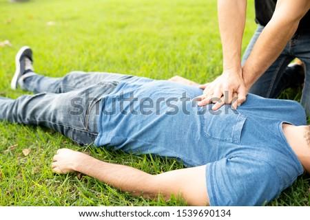 First Aid Emergency CPR rcp on Heart Attack Man , Resuscitation cardiopulmonary, coronavirus covid19 #1539690134