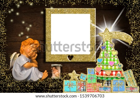 Christmas photo frame postcard with blank space for message or photo.  Sleeping angel, Baby Jesus in his crib ang Christmas tree with gifts on an old wooden background, copy space.
