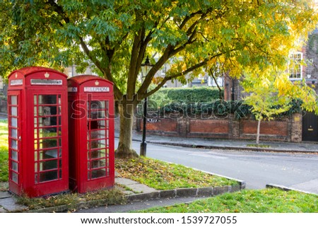 Red telephone booths in London #1539727055
