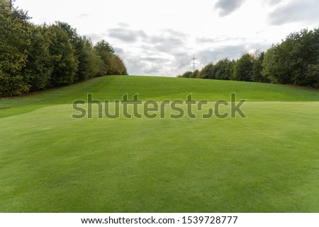 Golf Course with beautiful green field and hills #1539728777