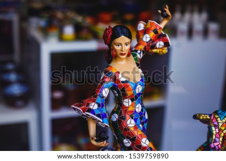 View of traditional tourist souvenirs and gifts from Spain, Alicante, Valencia with toys, bull figures, flamenco dancer dolls, fridge magnets with and key ring keychain, in local vendor souvenir shop  #1539759890