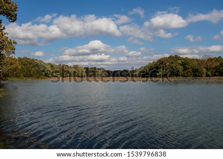 Blue sky with clouds over Lake Springfield on a fall day. #1539796838