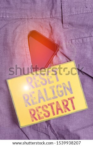 Conceptual hand writing showing Reset Realign Restart. Business photo showcasing Life audit will help you put things in perspectives Smartphone device inside trousers front pocket note paper. #1539938207