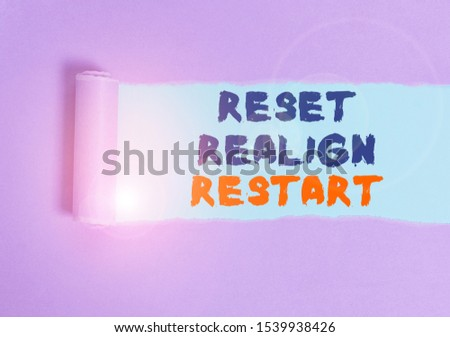 Handwriting text Reset Realign Restart. Concept meaning Life audit will help you put things in perspectives Cardboard which is torn in the middle placed above a plain table backdrop. #1539938426