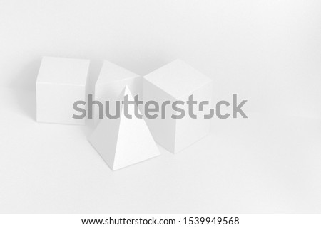 White geometrical Platonic solids figures still life composition, simplicity concept.  Three-dimensional prism pyramid rectangular cube objects on white background. #1539949568