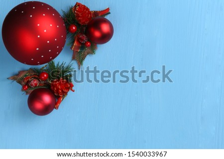 on a blue monophonic background lies a big red ball and Christmas decorations #1540033967