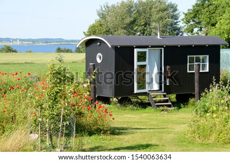 tiny house garden nature mobile home Royalty-Free Stock Photo #1540063634